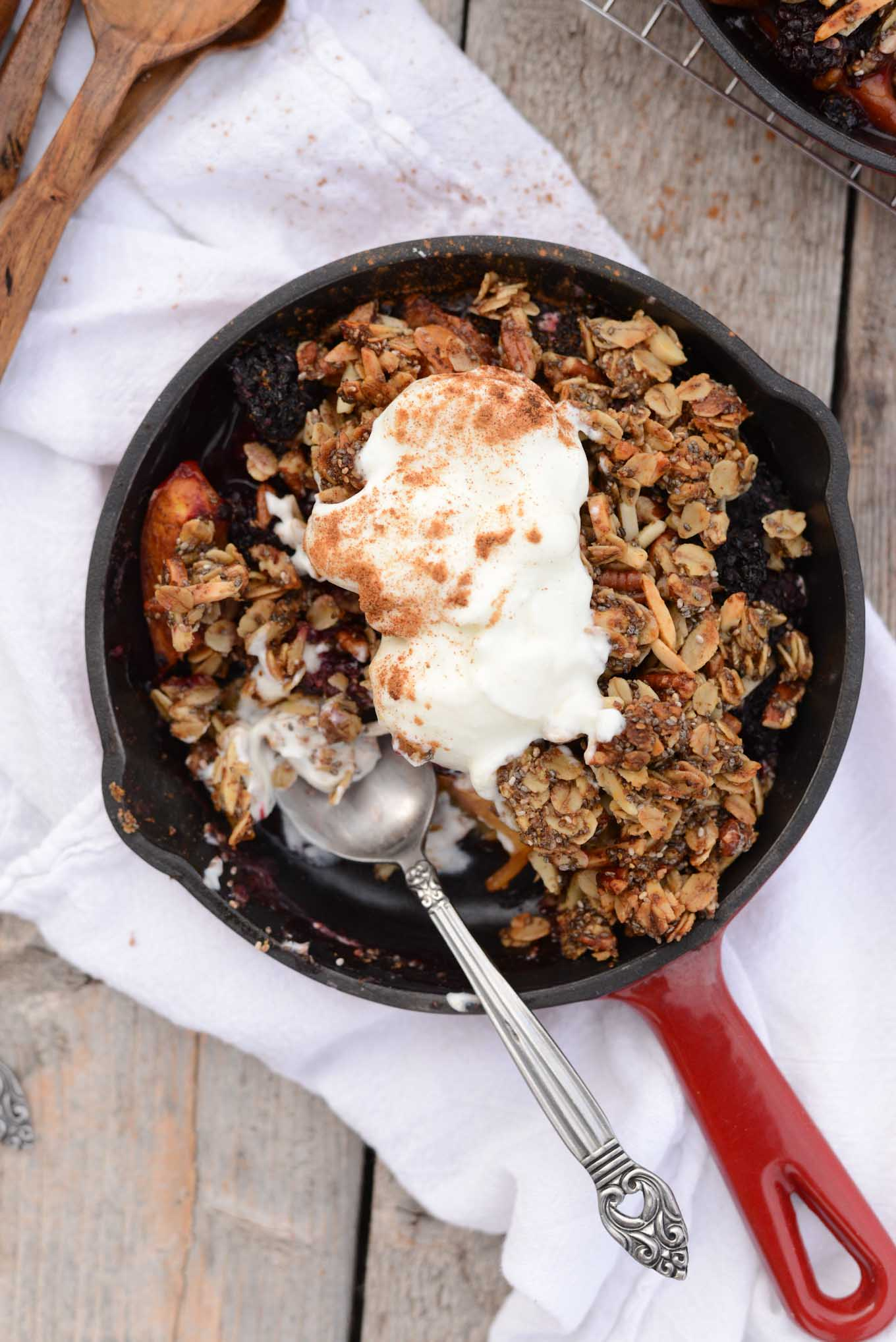 Fresh juicy nectarines with blackberries in this spiced skillet crisp for two.