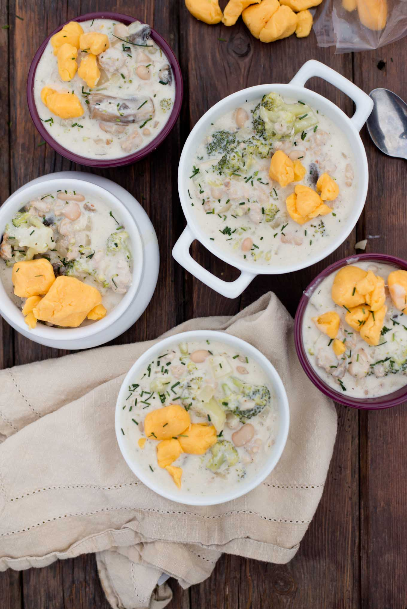 Creamy and delicious this healthified version of broccoli cheddar soup has half the cheese and extra protein.
