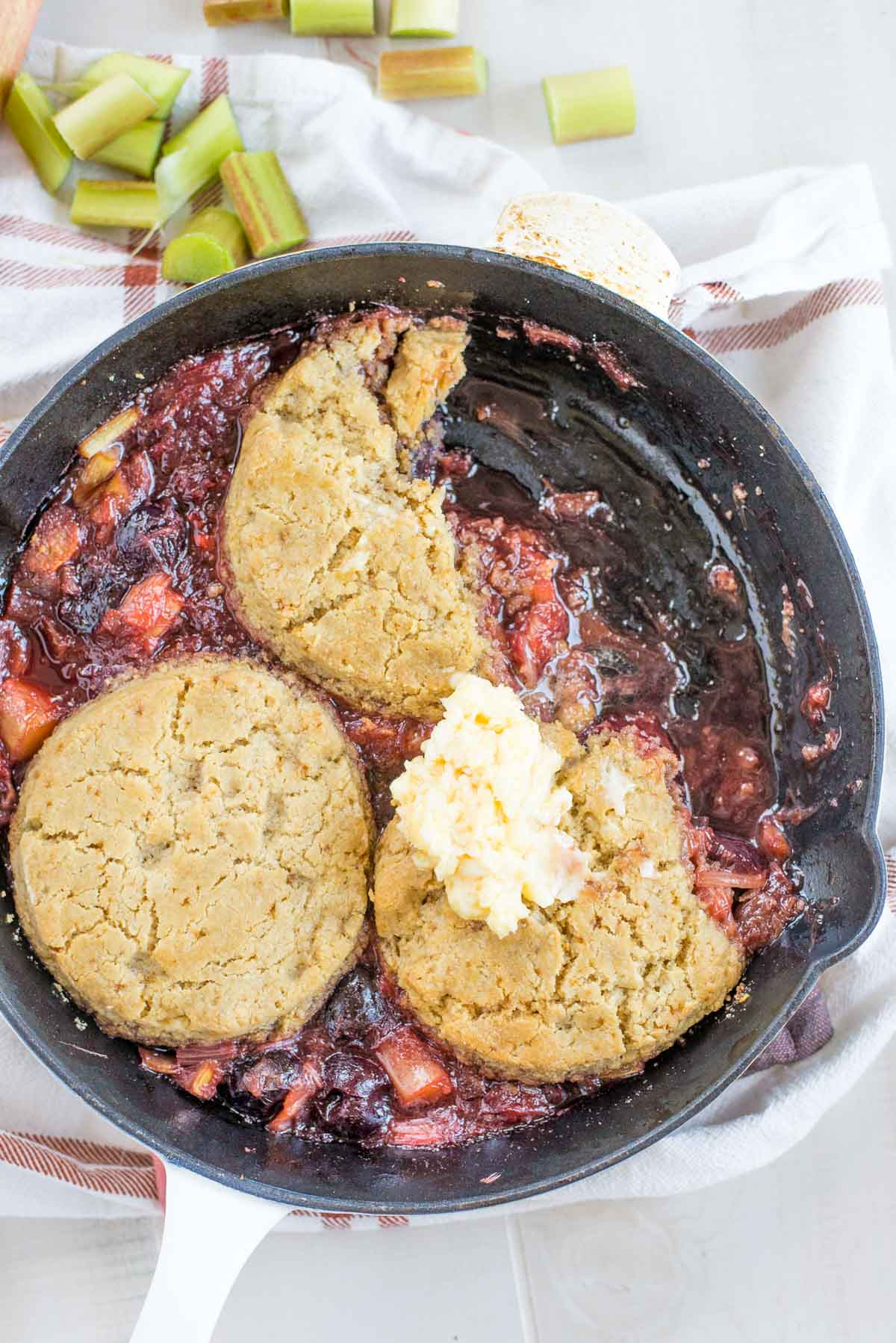 Looking for something delicious? Try this, it's the best cherry rhubarb cobbler with honey buttered biscuits. Seriously it's that good.