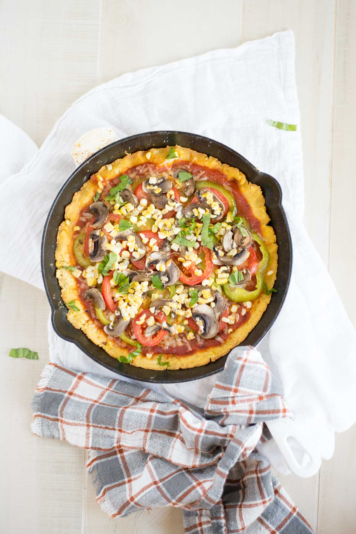 One dish skillet pizza with a cornbread crust is too perfect not to try. Load it with your favorite toppings and enjoy.