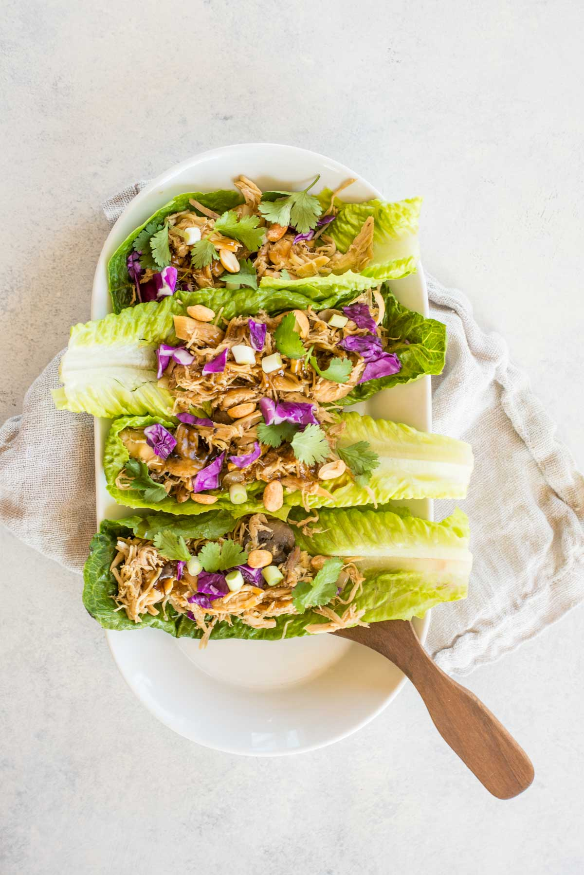 This recipe takes healthy to the next level with flavorful delicious Asian Chicken Lettuce Wraps.